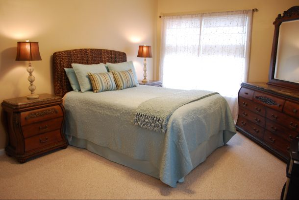 Master Bedroom with windows overlooking patio and pool area.