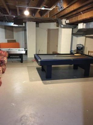 Game room pool, air hockey, projection tv, fios, game console.