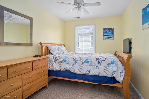 This bedroom has recently been updated to add a full-size bed, to go along with the queen bed. The dresser has been removed. New picture to follow soon.