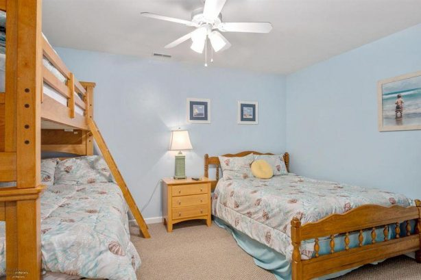 This bedroom has recently been updated to add a 55 inch TV and an additional set of twin bunk beds (in place of the full-size bed, which has been removed). This room now features two sets of bunk beds.