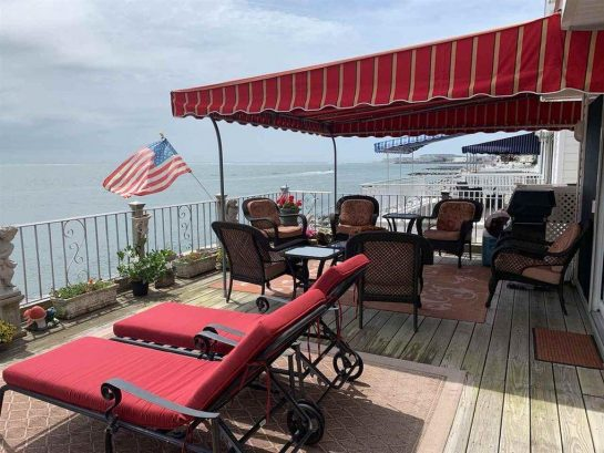 Partial Covered Deck with ample seating and spectacular ocean view