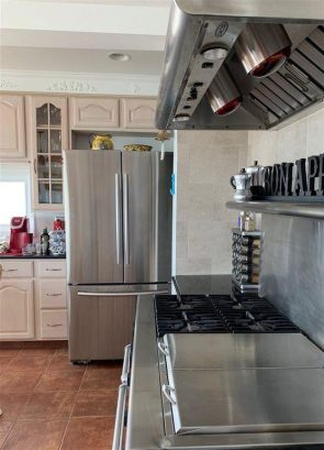 Gourmet Stove with griddle, double oven, heat lamp, ice maker refrigerator