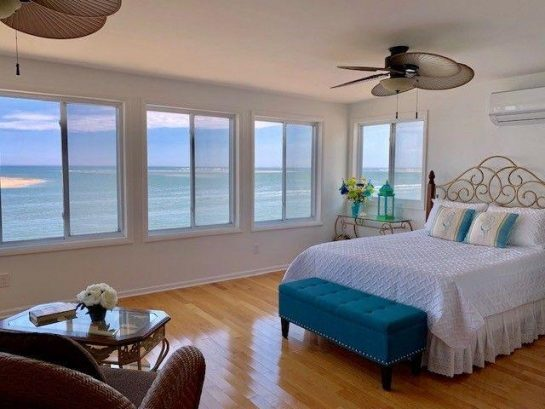Upper Bedroom Suite with Queen bed, private bath, central air, oceanfront view, sitting area