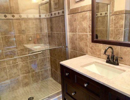 Hallway tiled bathroom