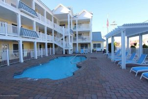 Enjoy affordable luxury ground level condo- pool - one block to beach