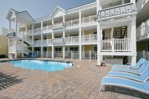 Ocean View End Unit Condo w/Covered Patio Area & Pool. 1 Block to the Beach