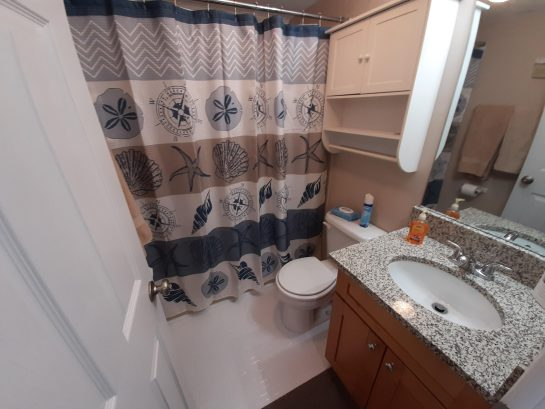 Full bath with tub/shower and new vanity with granite top.