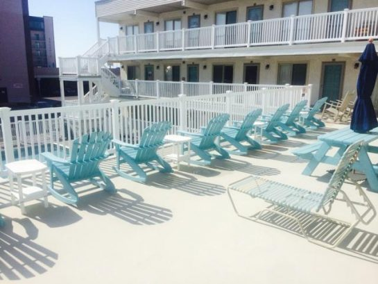 Deck chairs, picnic table, and lounges on large sundeck.