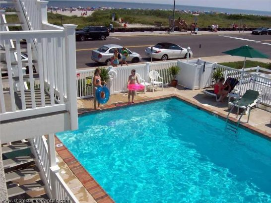 View of pool from deck outside the condo