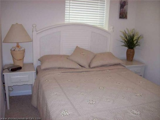 Queen size bed with night tables and dresser
